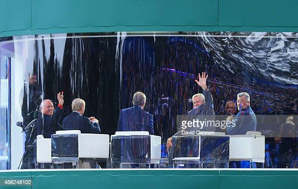 Butch Harmon and Colin Montgomerie wave from the Sky Sports studio during the Singles Matches of the 2014 Ryder Cup on the PGA Centenary course at...