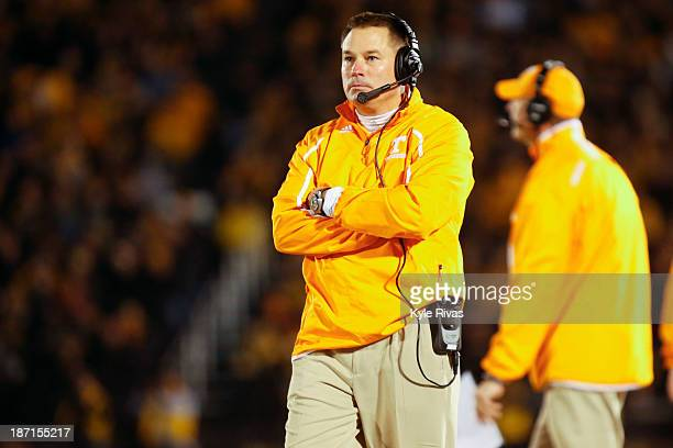 Butch Jones head coach of the Tennessee Volunteers paces up the field in the second quarter during the game against the Missouri Tigers on November...