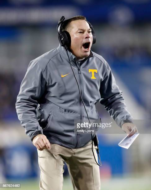 Butch Jones the head coach of the Tennessee Volunteers gives instructions to his team against the Kentucky Wildcats at Commonwealth Stadium on...