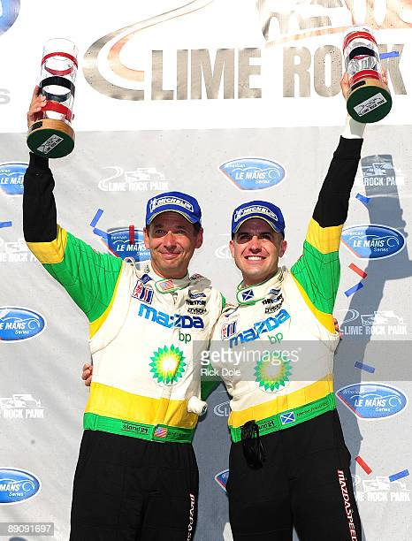Butch Leitzinger of the United States and Marino Franchitti of Scotland celebrating after driving the Dyson Racing Mazda Lola to victory in the LMP2...