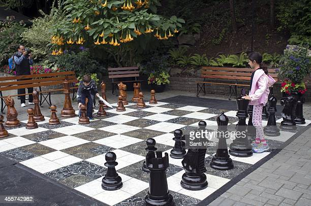 Butchart Gardens Children playing chase on August 30 2014 in Victoria British Columbia Canada