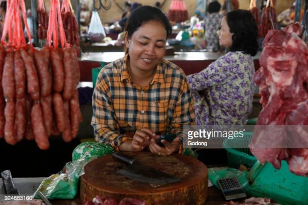 Butcher at a Battambang market Cambodia