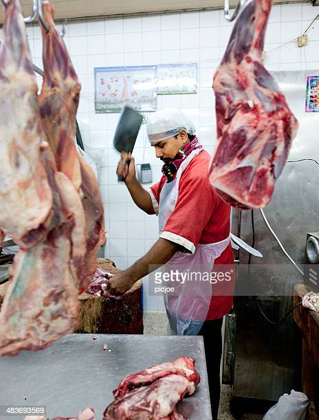 butcher at work on meat market in Dubai