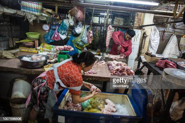 A butcher cuts pork at a stall at Orussey Market in Phnom Penh Cambodia on Friday July 27 2018 Cambodian Prime MinisterHun Senextended his...