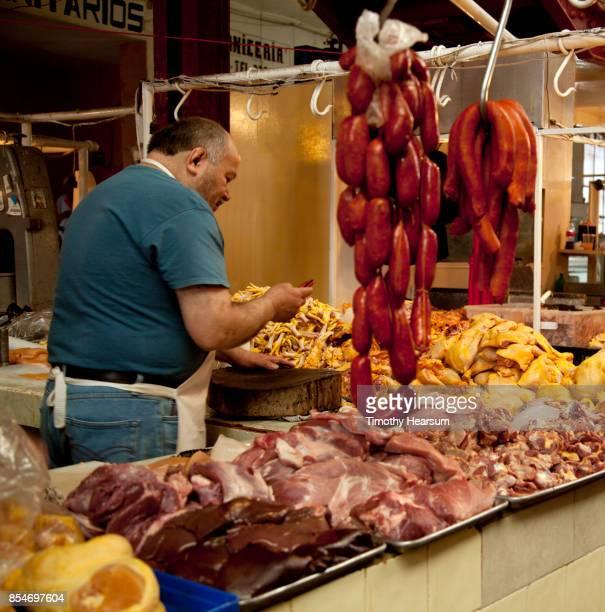 butcher displays an array of meat at a market - timothy hearsum photos et images de collection