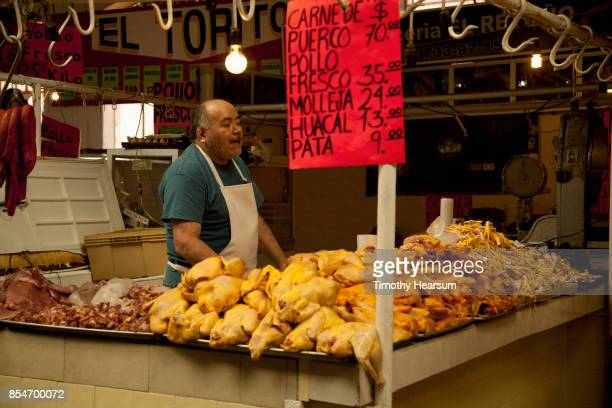 butcher displays an array of meat at a market - timothy hearsum stock pictures, royalty-free photos & images