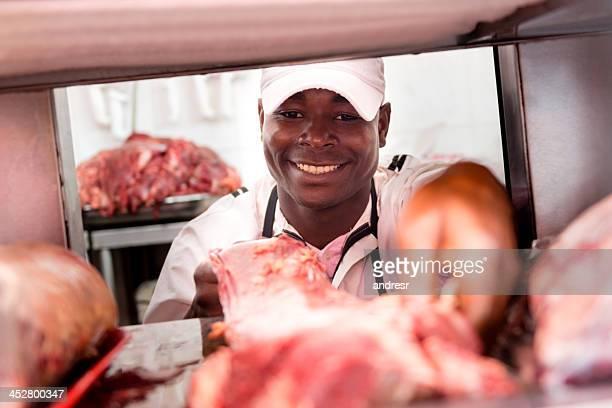 Butcher hält Fleisch