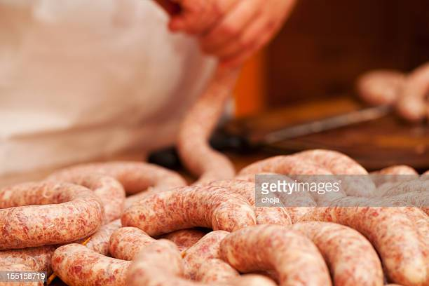 Butcher is making delicious Slovene pork sausages