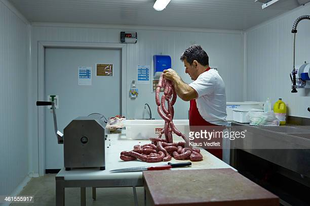butcher making sausages at slaughterhouse - klaus vedfelt mallorca stock pictures, royalty-free photos & images