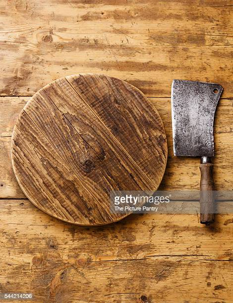 Butcher Meat cleaver and Chopping board block on wooden background