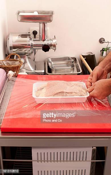 butcher preparig meat