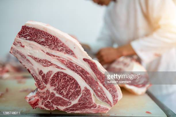 butcher process cutting ribeye wagyu beef in the slaughterhouse - cutting stock pictures, royalty-free photos & images
