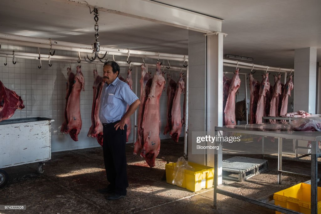 A butcher purchases pork at the Obrador Muoz meat wholesale and distribution center in San Luis Potosi, Mexico, on Friday, June 8, 2018. Mexico will begin to tax a range of U.S. products, including pork, in retaliation for tariffs on Mexican steel and aluminum that PresidentDonald Trump announced last week. Mexico is the largest market for U.S.porkexports, accounting for around 25% of last year's shipments, according to the NationalPorkProducers Council. Photographer: Mauricio Palos/Bloomberg via Getty Images