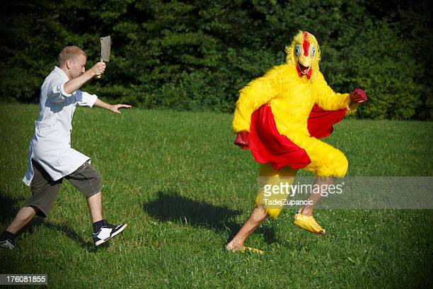 butcher running after chicken - animal costume stock pictures, royalty-free photos & images