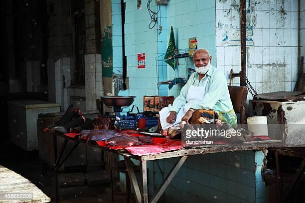 Butcher Selling Bulls Trotters in Asian Bazaar, Empress Market