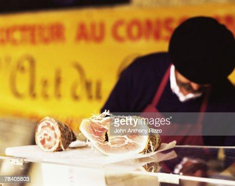 Butcher selling pancetta