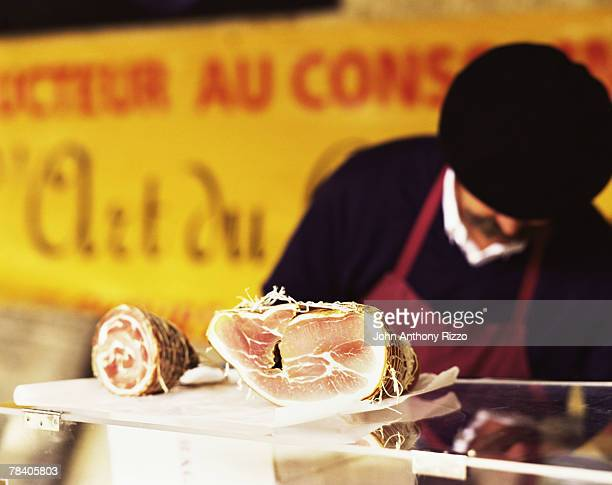 Butcher selling pancetta