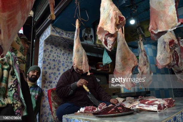 A butcher sells mutton in his shop during a sunny day in Srinagar the summer capital of Indian controlled Kashmir on Friday 16 November 2018