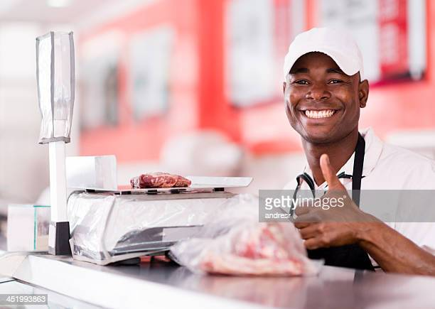 Butcher with thumbs up