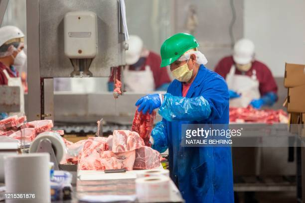 Butchers chop up beef at Jones Meat & Food Services in Rigby, Idaho, May 26, 2020. - As coronavirus clusters in slaughterhouses around the world...