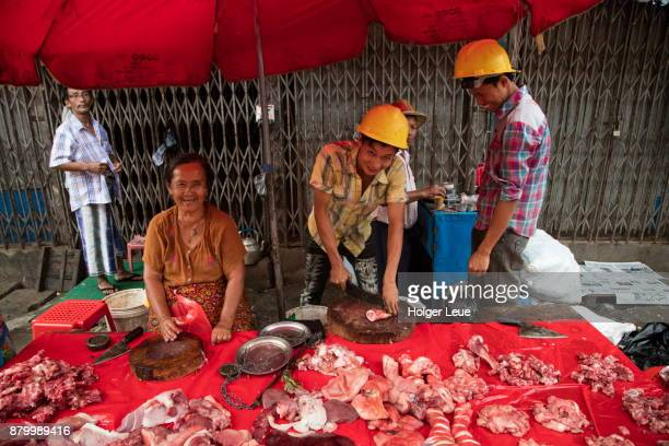 Butchers sell meat at 18th Street Market in Chinatown, Yangon, Yangon, Myanmar