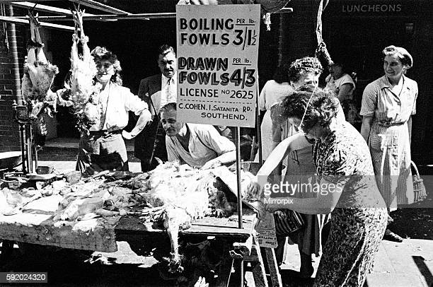 Butchers stall at a market in Whitechapel, East London. Circa 1947.