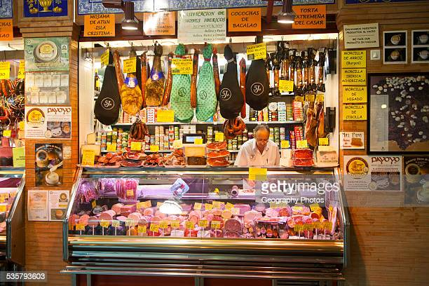 Butchers stall in historic market building in Triana Seville Spain