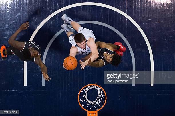 Butler Bulldogs center Nate Fowler shoots over Cincinnati Bearcats forward Jacob Evans in the lane during the NCAA men's basketball game between the...