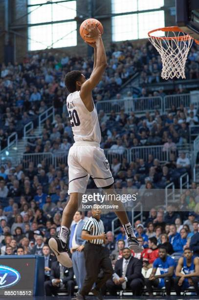 Butler Bulldogs forward HenryBaddley goes up for a dunk on a fast break during the men's college basketball game between the Butler Bulldogs and...
