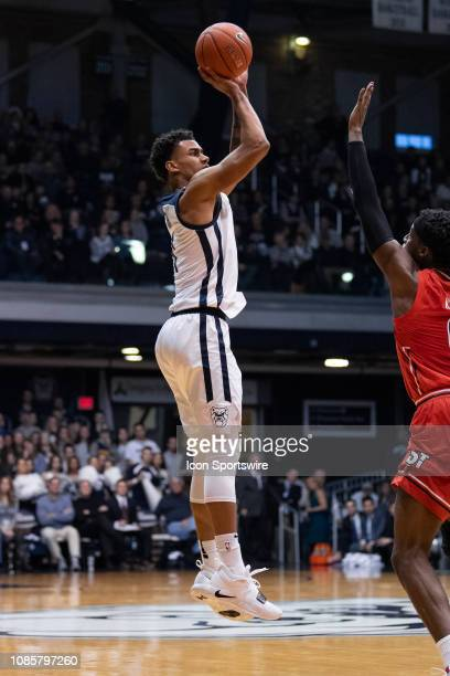 Butler Bulldogs forward Jordan Tucker shoots a three pointer during the men's college basketball game between the Butler Bulldogs and St John's Red...