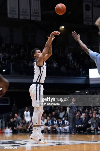 Butler Bulldogs forward Jordan Tucker shoots a three pointer during the men's college basketball game between the Butler Bulldogs and Marquette...