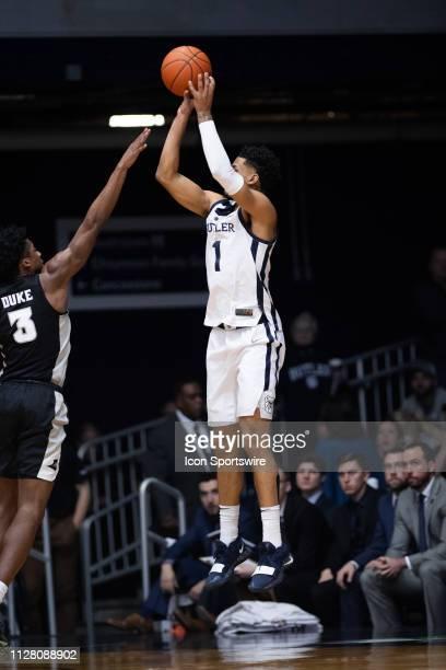 Butler Bulldogs forward JordanTucker shoots a three pointer over Providence Friars guard David Duke during the men's college basketball game between...