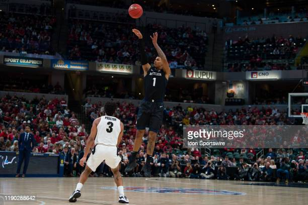 Butler Bulldogs forward JordanTucker shoots a three pointer over Purdue Boilermakers guard Jahaad Proctor during the Crossroads Classic college...