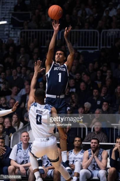 Butler Bulldogs forward JordanTucker shoots a three pointer over UC Irvine Anteaters forward JC Butler during the men's college basketball game...
