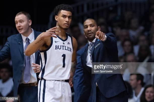 Butler Bulldogs forward JordanTucker talks to Butler Bulldogs head coach LaVall Jordan on the sidelines during the men's college basketball game...