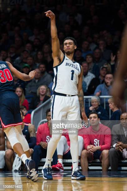 Butler Bulldogs forward JordanTucker watches a three pointer during the men's college basketball game between the St John's Red Storm and Butler...