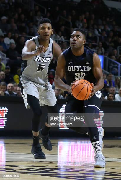 Butler Bulldogs forward Kelan Martin drives past Providence Friars forward Rodney Bullock during a college basketball game between Butler Bulldogs...