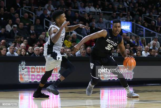 Butler Bulldogs forward Kelan Martin drives to the basket defended by Providence Friars forward Rodney Bullock during a college basketball game...