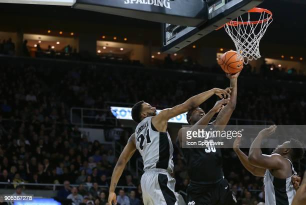 Butler Bulldogs forward Kelan Martin shoots over Providence Friars guard Jalen Lindsey during a college basketball game between Butler Bulldogs and...