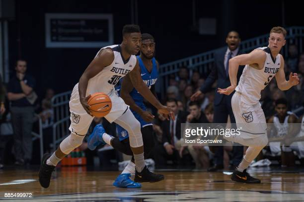 Butler Bulldogs forward KelanMartin brings the ball up the court on a fast break during the men's college basketball game between the Butler...