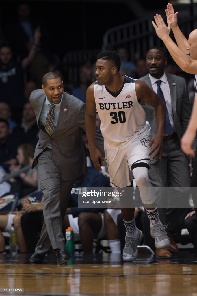 Butler Bulldogs forward Kelan Martin (30) gets a smack from Butler Bulldogs head coach LaVall Jordan after hitting a three pointer during the men's college basketball game between the Butler Bulldogs and Creighton Bluejays on February 20, 2018, at Hinkle Fieldhouse in Indianapolis, IN.