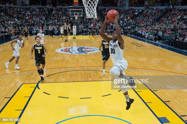 Butler Bulldogs forward KelanMartin goes in for a dunk on a fast break during the Crossroads Classic basketball game between the Butler Bulldogs and...