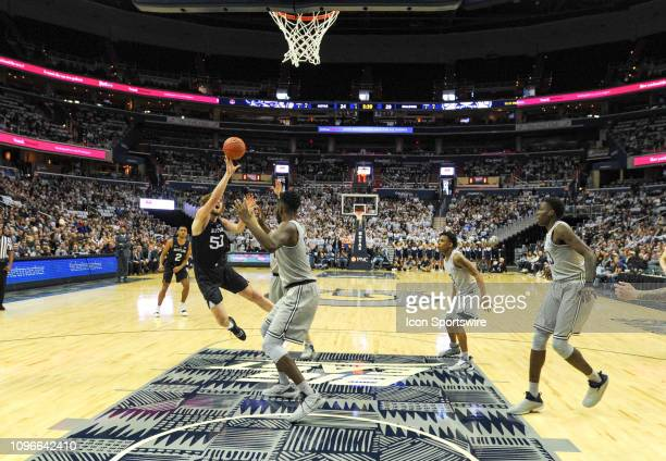 Butler Bulldogs forward Nate Fowler us fouled by Georgetown Hoyas center Jessie Govan in the first half on February 9 at the Capital One Arena in...