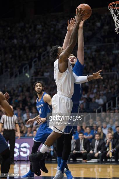 Butler Bulldogs forward Tyler Wideman drives by Creighton Bluejays center Jacob Epperson for a layup during the men's college basketball game between...