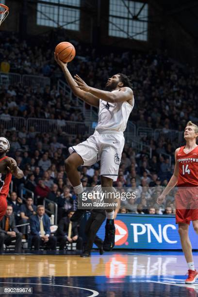 Butler Bulldogs forward TylerWideman scores on a fast break during the men's college basketball game between the Butler Bulldogs and Youngstown...