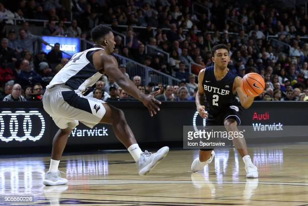 Butler Bulldogs guard Aaron Thompson passes the ball while defended by Providence Friars guard Isaiah Jackson during a college basketball game...
