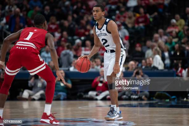 Butler Bulldogs guard AaronThompson brings to ball up the court against Indiana Hoosiers guard Aljami Durham during the Crossroads Classic...