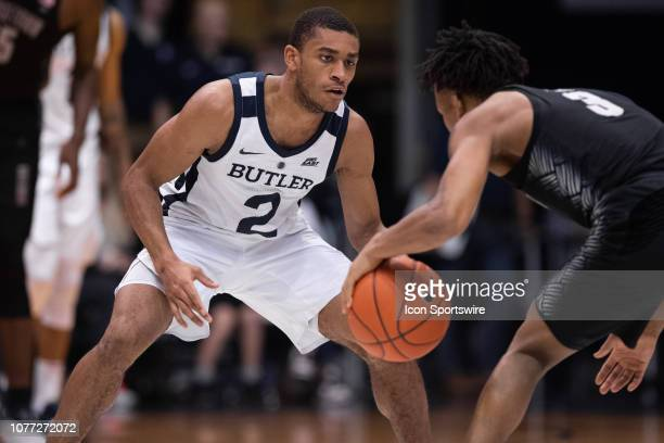 Butler Bulldogs guard Aaron Thompson defends Georgetown Hoyas guard James Akinjo on the perimeter during the men's college basketball game between...
