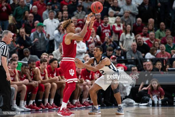 Butler Bulldogs guard AaronThompson defends Indiana Hoosiers guard Romeo Langford on the perimeter during the Crossroads Classic basketball game...
