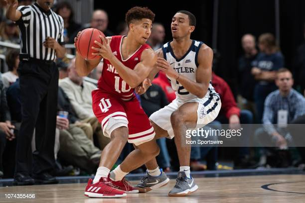 Butler Bulldogs guard AaronThompson pressures Indiana Hoosiers guard Rob Phinisee on the perimeter during the Crossroads Classic basketball game...